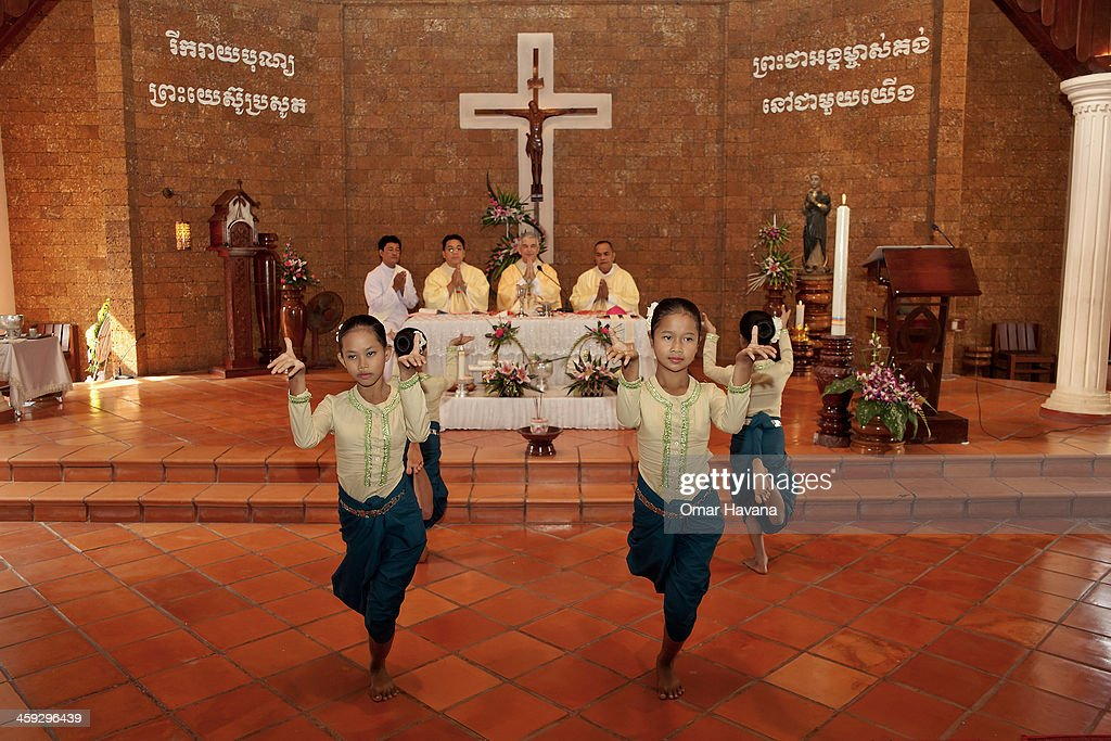 A group of young dancers perform a dance during the Christmas day mass at the church of Our Lady of the Assumption on December 25, 2013 in Battambang, Cambodia. The parish at Battambang dates back to 1790 when the Catholic community first arrived. Now they serve around 1000 Catholics and 600 families.