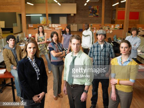 Group of young executives standing in office, portrait : Stock Photo
