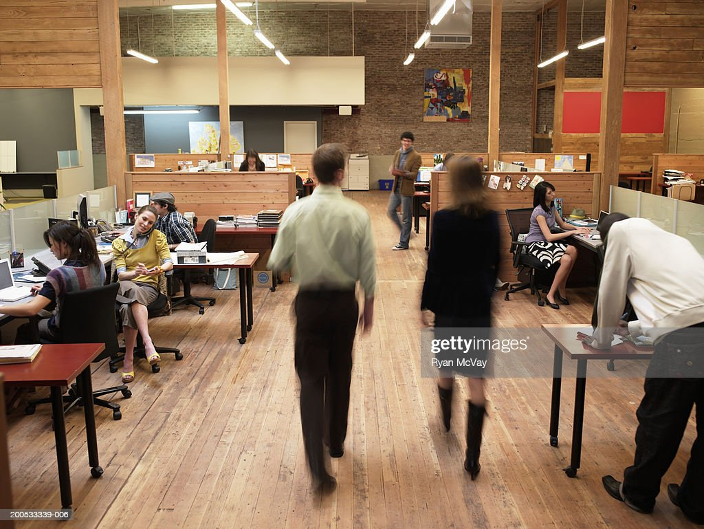 Group of young executives working in office (blurred motion) : Stock Photo
