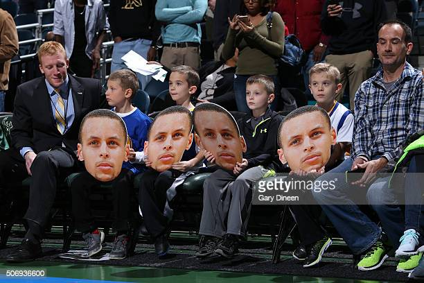 A group of young fans hold a cut out of Stephen Curry of the Golden State Warriors during the game against the Milwaukee Bucks on December 12 2015 at...