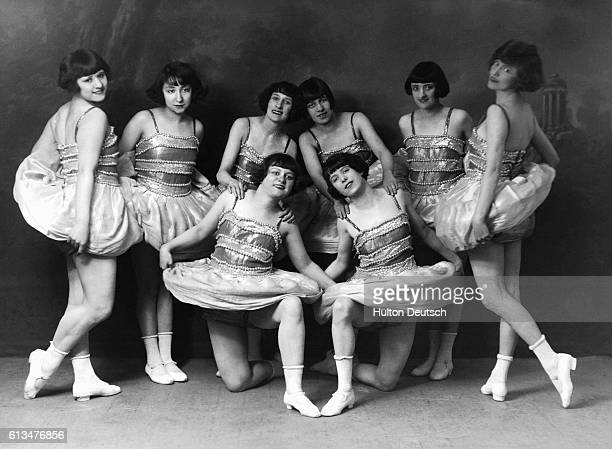 A group of young female cabaret dancers from the 1920's pose in their costumes