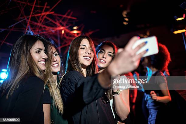 Group of young females taking a selfie