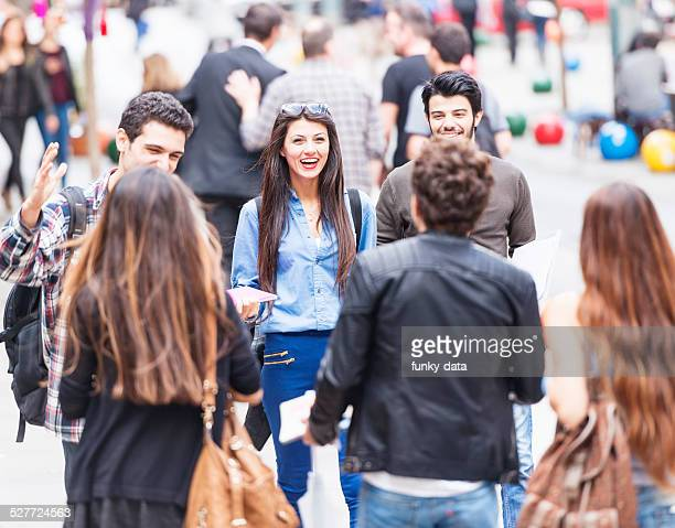 Group of young friends encounter on the street