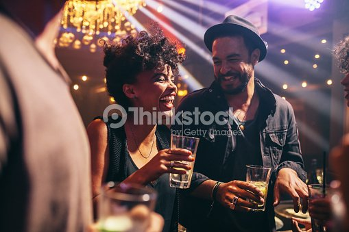 Group of young friends on a night out : Stock Photo