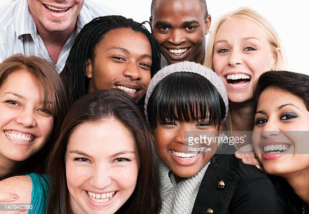 Group of young friends or colleagues smile together