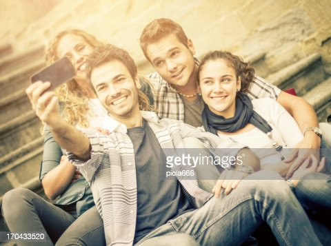 Group of young friends self portrait with smartphone : Stock Photo