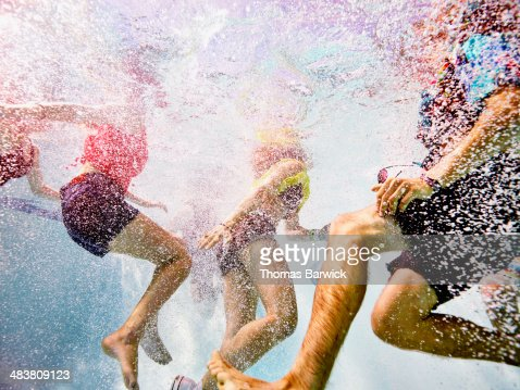 Group of young friends swimming in pool