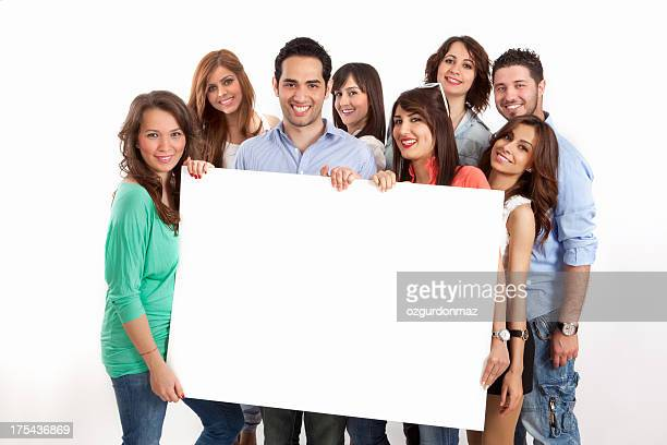 Group of young friends with a banner ad