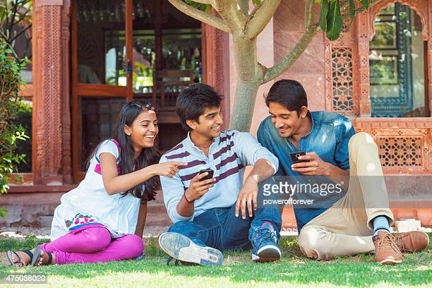 Group of Young Indian Friends Using Smart Phones