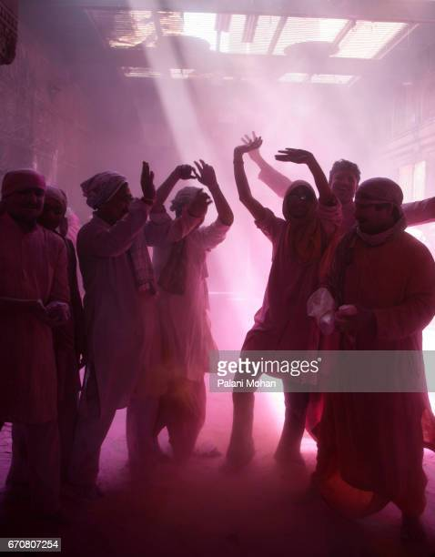 A group of young Indian men dance and throw pink powder as part of the Holi Celebrations at the Sri Banke Bihari Temple March 20 2008 in Vrindavan...