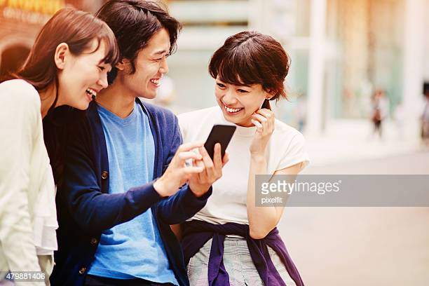 Group of young japanese people with smart phone
