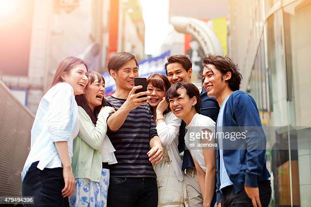 Group of young japanese people with smart phone, Shibuya, Tokyo.