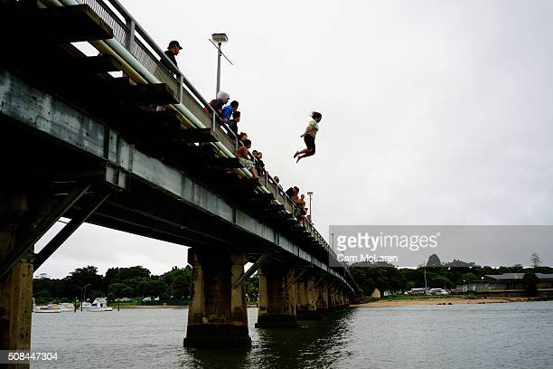 A group of young men and woman find a moment of release away from the local proceedings on February 5 2016 in Waitangi New Zealand The Waitangi Day...