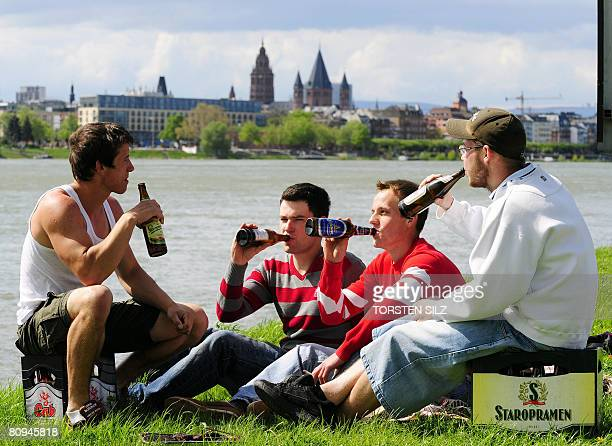 A group of young men drink beer on May 1 2008 on the occasion of Father's Day in the western German city of Mainz On Father's Day in Germany which...