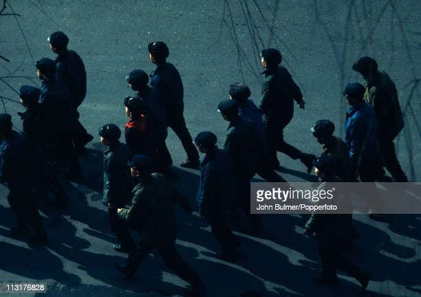 A group of young North Korean men in regulation clothing North Korea February 1973