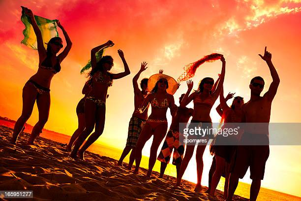 Group of young people at a hot summer beach party