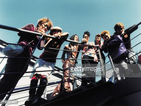 Group of young people at staircase, elevated view : Stock Photo