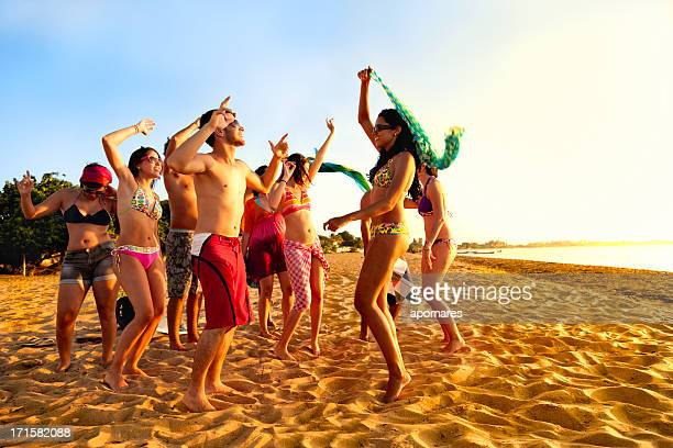 Group of young people at tropical beach party
