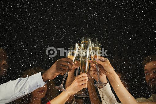 Group of young people celebrating new year with champagne at night club : Stock Photo