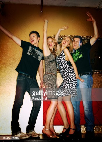 Group of young people dancing in nightclub : Stock Photo