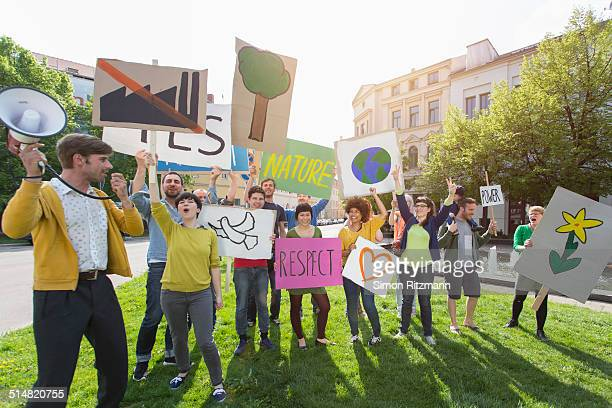 Group of young people demonstrating with banners