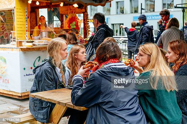 Group of young people eating in Camden Market, London