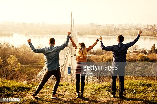 Group of young people enjoy sunny day near Danube river
