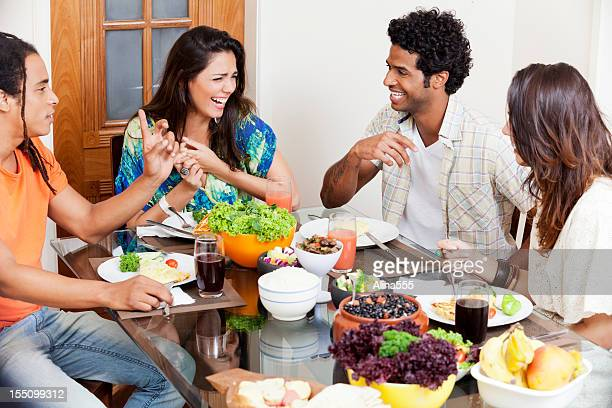 Group of young people enjoying conversation over lunch
