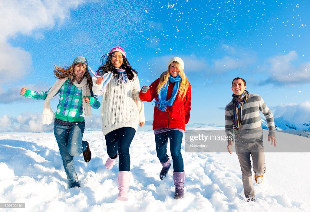 Group of Young People enjoying Winter : Stock Photo