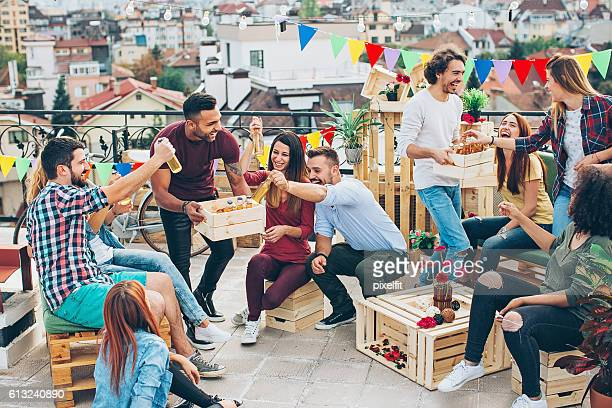 Group of young people having a rooftop party