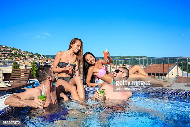 Group of young people having fun on swimming pool