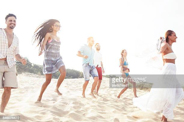 Group of young people having fun on the beach