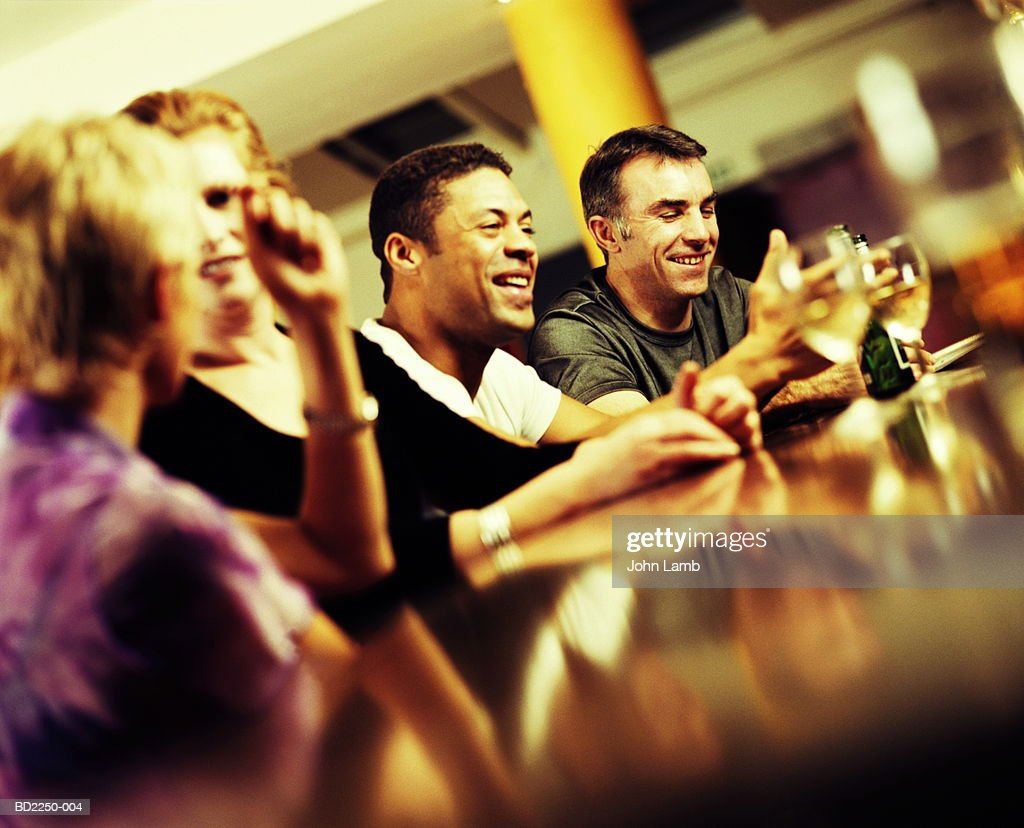 Group of young people in wine bar talking and drinking (Enhancement) : Stock Photo
