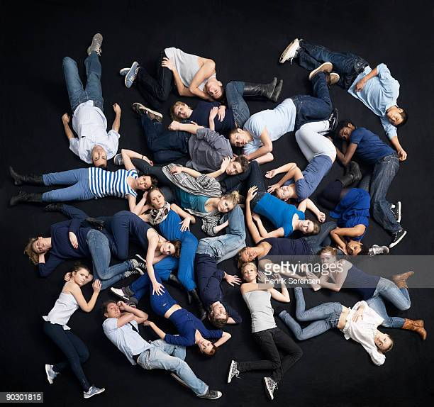 group of young people lying on the floor