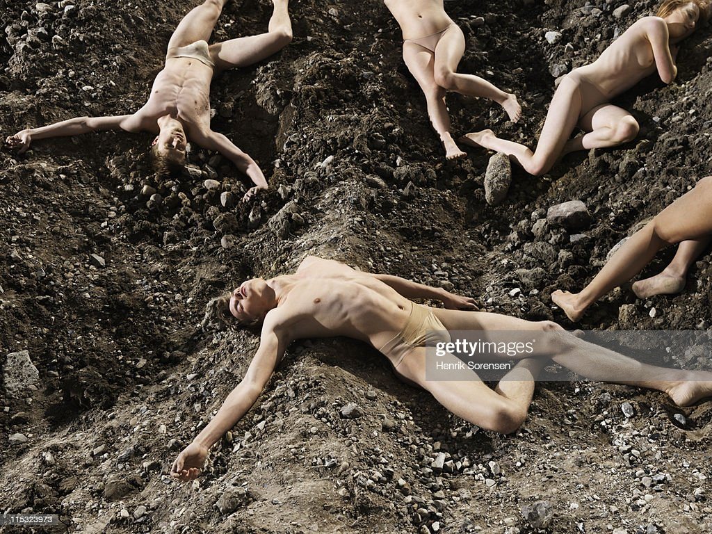 group of young people lying on the ground : Stock Photo
