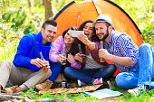 Group of young people making selfie in the forest