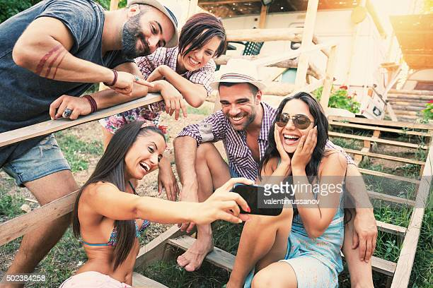 Group of young people making selfie on stairs outdoor
