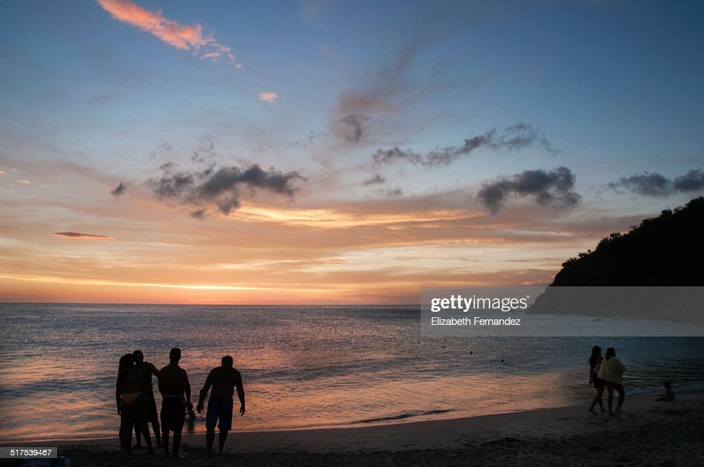 Group Of Young People On Beach At Sunset Stock Photo ...