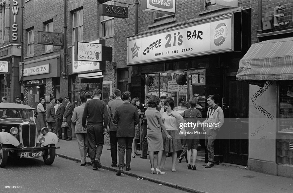 A group of young people outside the 2 I's coffee bar in Soho, London, April 1961.