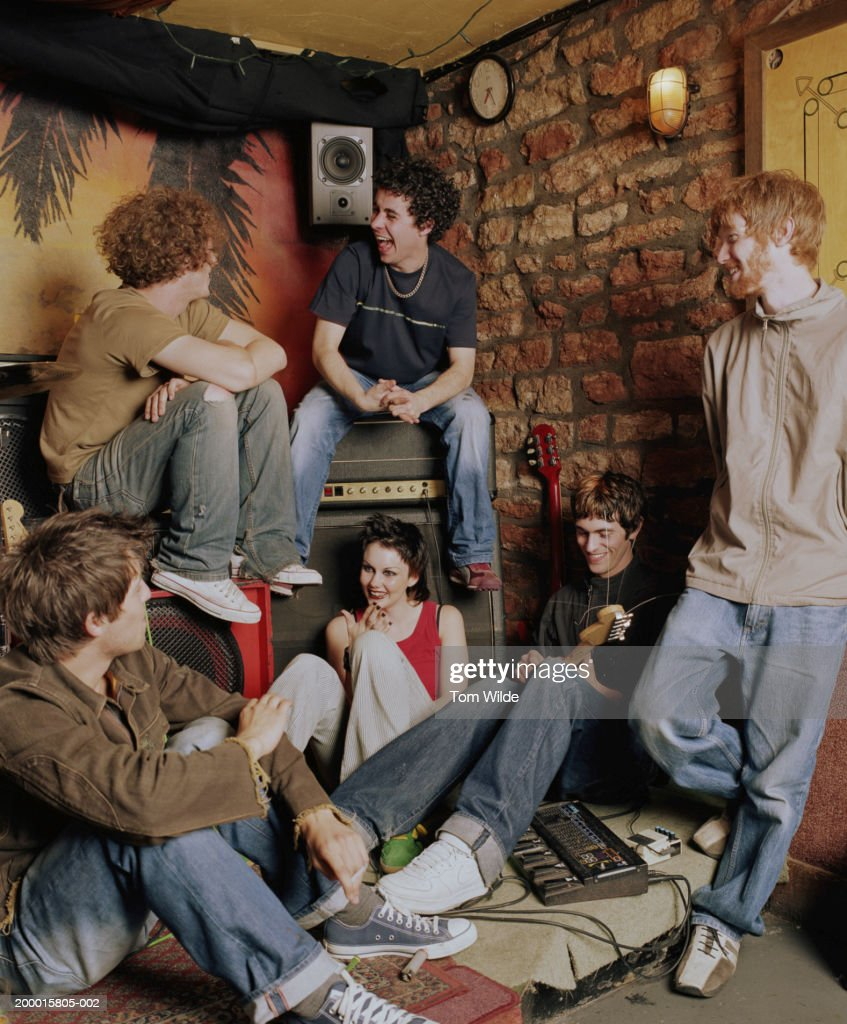 Group of young people relaxing by guitars and speakers : Stock Photo