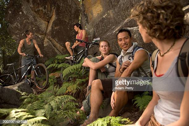 Group of young people relaxing by rock face