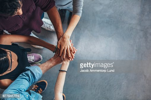 Group Of young people stacking their hands : Stock-Foto