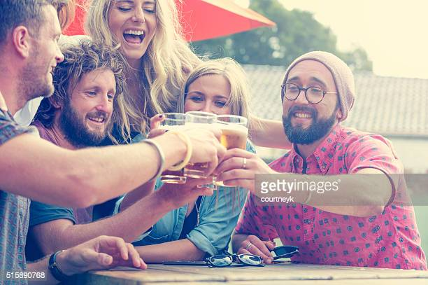 Group of young people toasting with beer.
