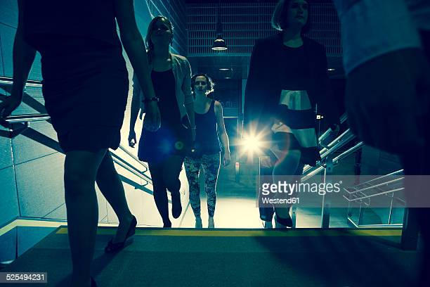 Group of young people walking in subway station