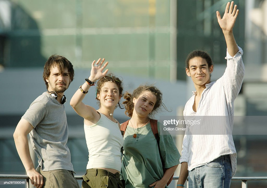 Group of young people waving
