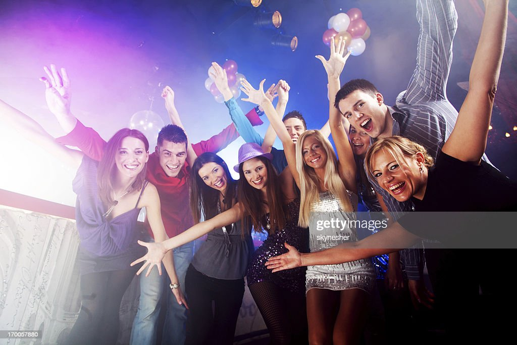 Group of beautiful young friends at the disco. : Stock Photo
