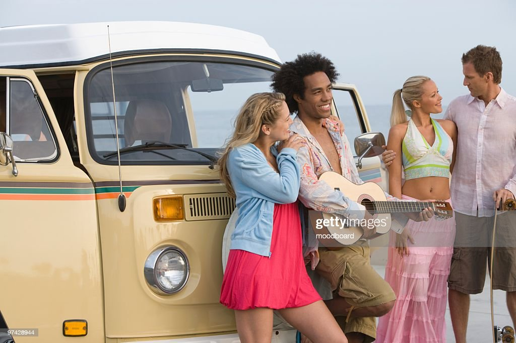 Group of young people with camper van : Stock Photo