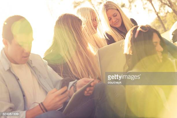 Group of young people with mobile devices.