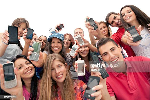 Group of young people with mobile phones.