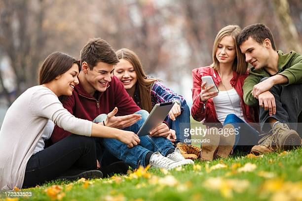 Group of young people with tablet and smartphone